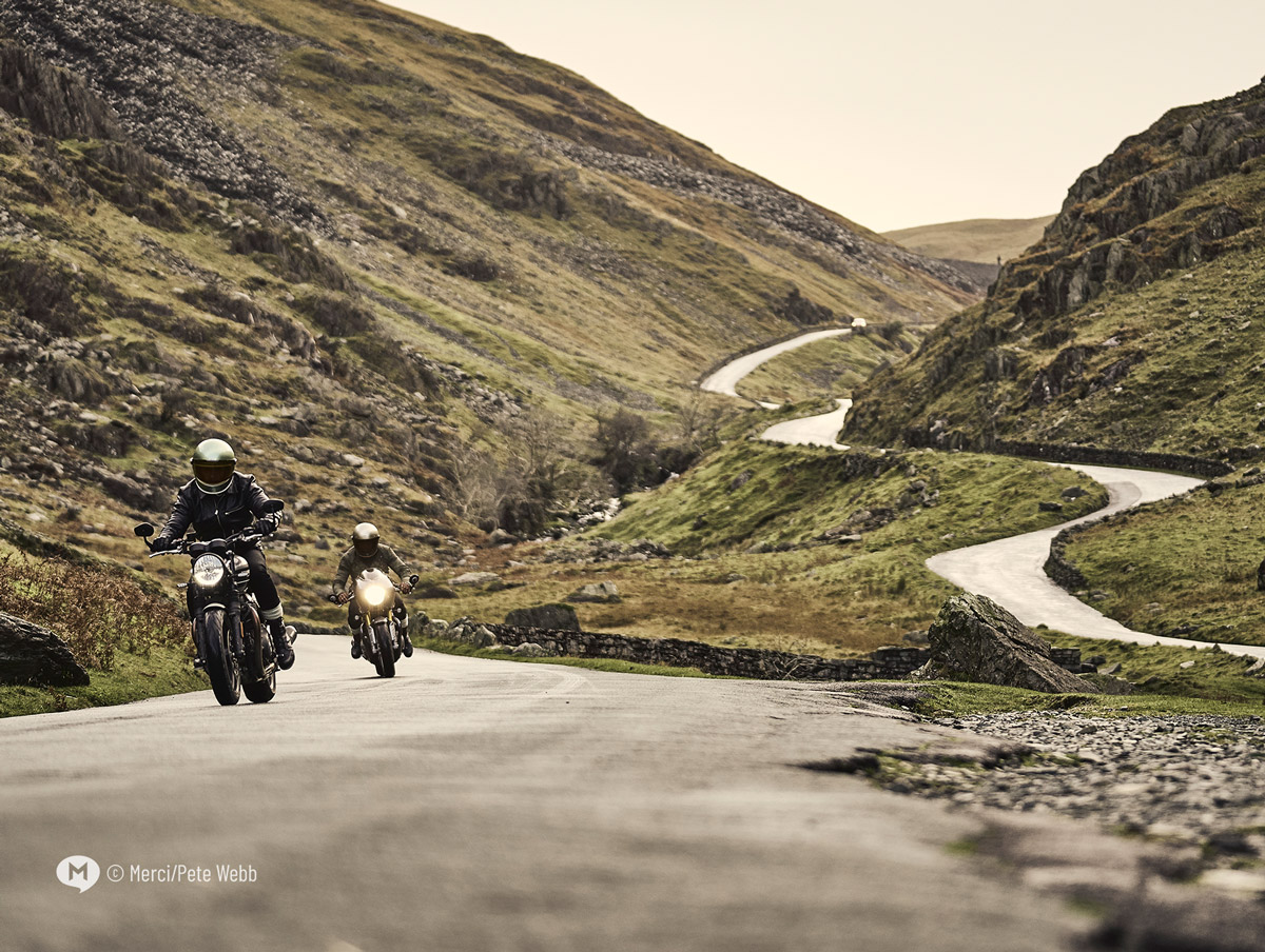 Two motorcyclists riding the Honister Pass in the English Lake District