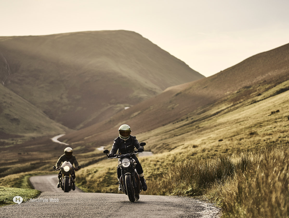 Two motorcyclists riding the