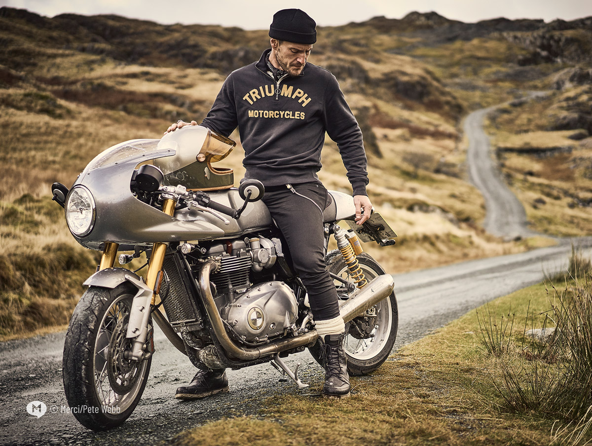 Motorcyclist wearing RADIAL CREW SWEATSHIRT BLACK, and sitting on Triumph motorcycle